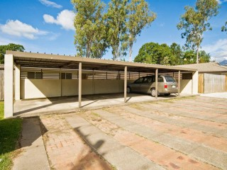 View profile: 1 bedroom unit with courtyard and carport