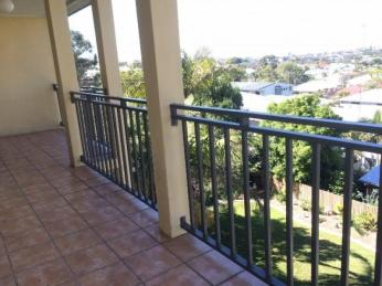 View profile: Impressive 2 bed 2 bath apartment - high on hill with a lovely outlook